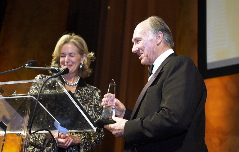Carolyn Schwenker Brody, Chair of the National Building Museum's Board of Trustees, presents the Vincent Scully Prize, a crystal obelisk, to His Highness the Aga Khan. | AKDN / Zahur Ramji