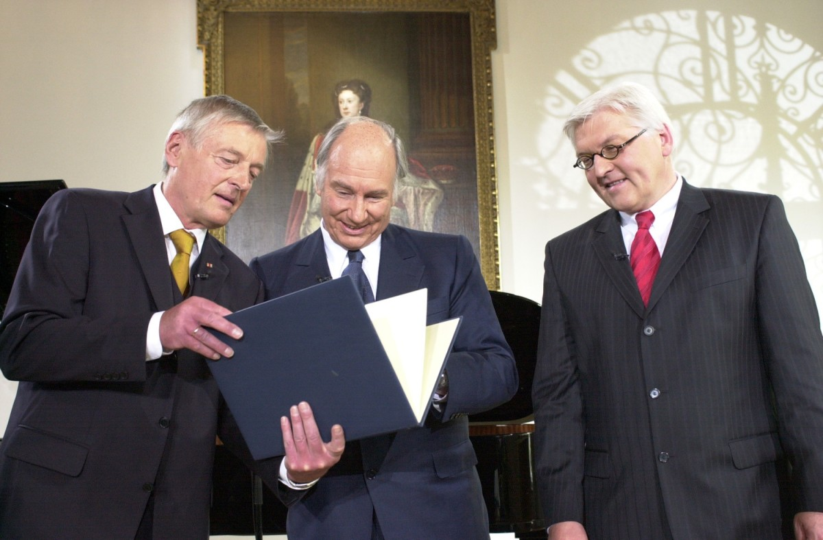 "Dr. Friedemann Greiner, Director and Chairman of the Jury (left), presenting the Tolerance Award 2006 to His Highness the Aga Khan as Dr Frank-Walter Steinmeier, Germany's Minister of Foreign Affairs (right), looks on. The Tolerance Award was established by Germany's Evangelische Akademie Tutzing in 2000 and is presented every second year to an individual whose life work is committed to building greater understanding and tolerance between different cultures and traditions. During his laudatory address, Dr Steinmeier described the Aga Khan as a ""fortress for democratic progress, as someone wishing to bring about sustainable, pluralistic, civil societies…We honour an exceptional man, we honour a huge friend of humankind, we honour a courageous visionary and we honour a person building bridges between societies,"" Photo: AKDN/Zahur Ramji."