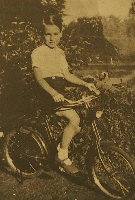 Prince Karim Aga Khan on his bicycle.