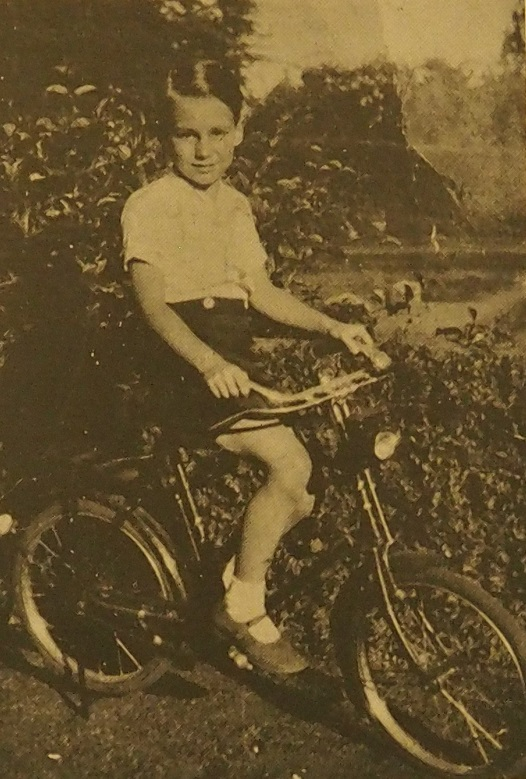 Prince Karim Aga Khan on his bicycle.