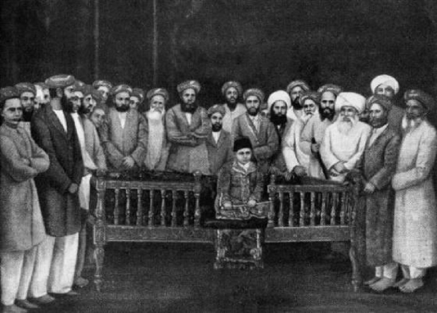September 1, 1885: The 7-year-old Aga Khan III at his enthronement ceremony as 48th Imam of the Shia Ismaili Ismaili Muslims in Bombay. He is surrounded by community elders. Photo: Keystone/Hulton Archive/Getty Images, Copyright