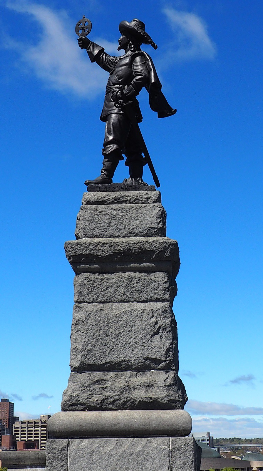 Statue of French explorer Samuel de Champlain at Nepean Point in Ottawa. The explorer is seen holding his famous astrolabe upsidedown. Nepean Point overlooks the Ottawa River, Parliament, the Canadian Museum of Civilization, and other features of downtown Ottawa and Gatineau. It is located between the National Gallery of Canada and Alexandra Bridge The sculpture was made by Hamilton MacCarthy in 1915. Photo: Simerg/Nurin and Malik Merchant, Copyright.
