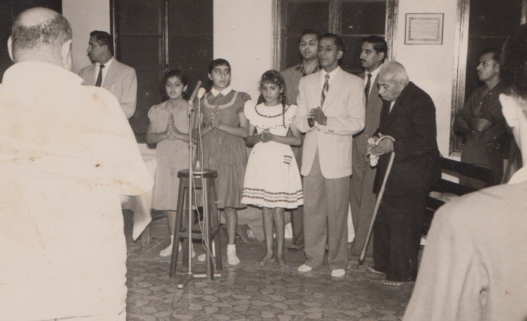 Alwaez Merchant joining in a student recitation in Lourenco Marques
