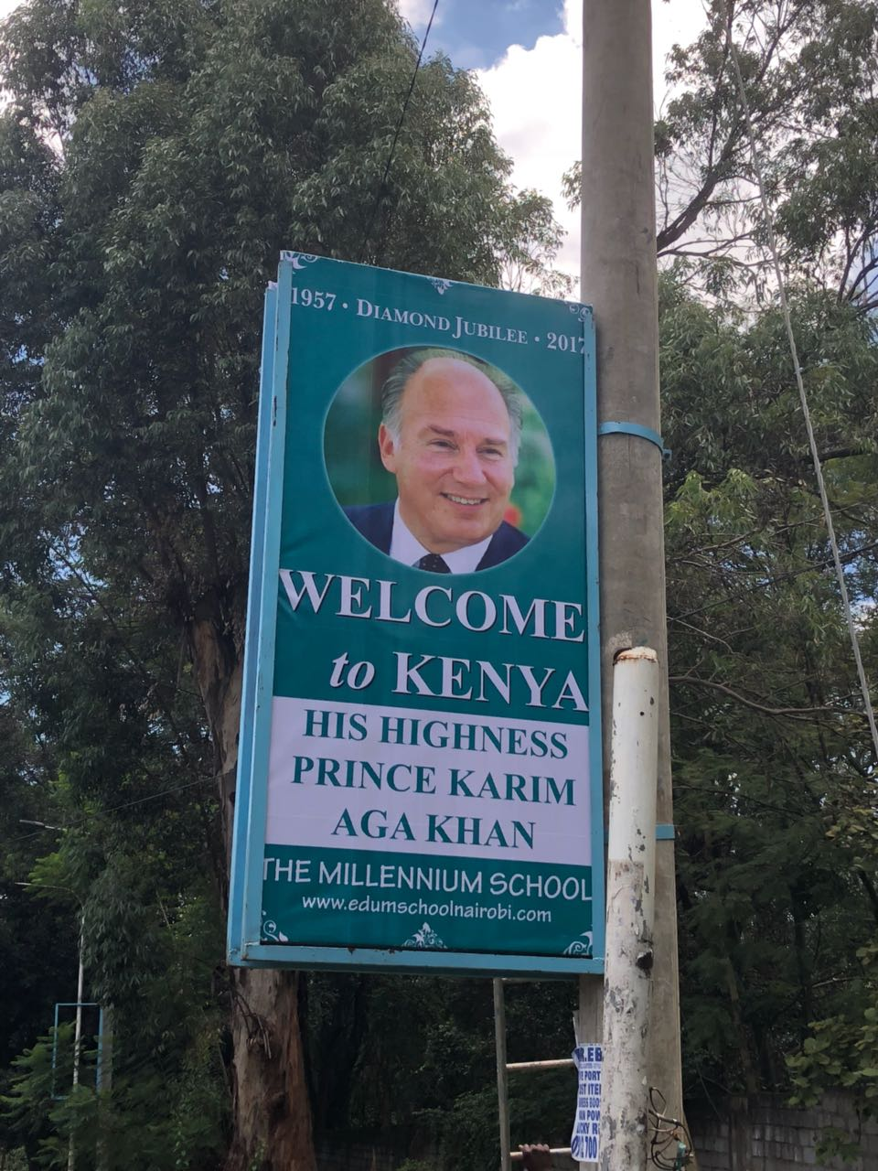2018-04-12-PHOTO-Aga Khan Visit Kenya Billboard at a school