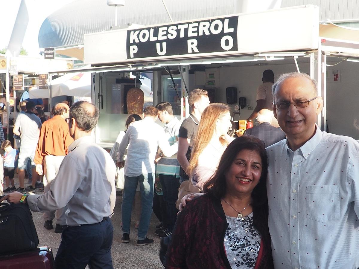 Salim and Nevin Kanji near food stand Kolesterol Puro