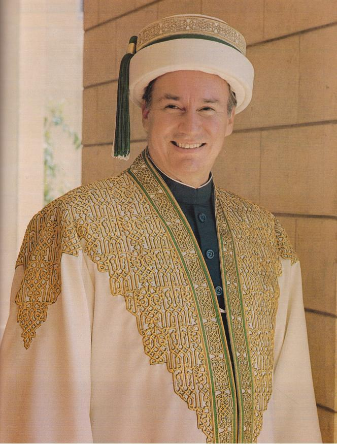 The seal of Aga Khan University and  convocation regalia of His Highness the Aga Khan