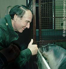 Prince Sadruddin with orphaned monk seal pup Efstratia