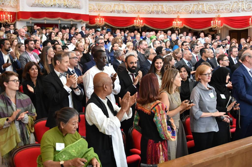audience standing ovation Aga Khan
