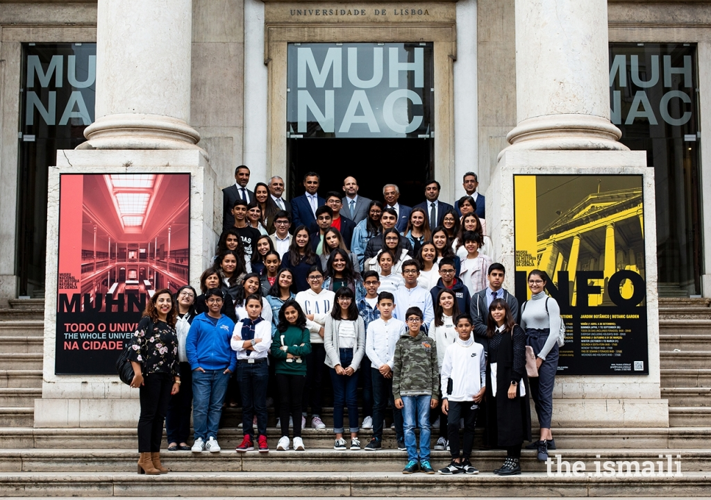 Prince Hussain poses for a group photograph with secondary students from the Lisbon Jamat's Talim (religious education) classes, at the National Museum of Natural History and Science in Lisbon.  José Fernandes