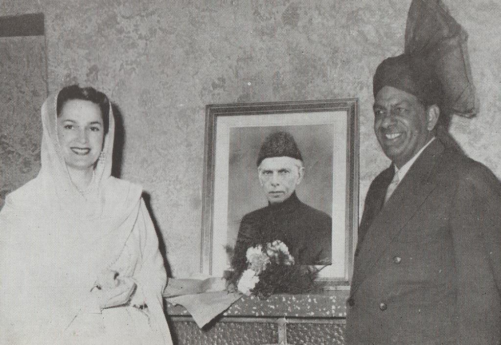 Begum Aga Khan at Pakistan Embassy in Iran flanked by a portrait of Pakistan's founder Quaid-i-Azam