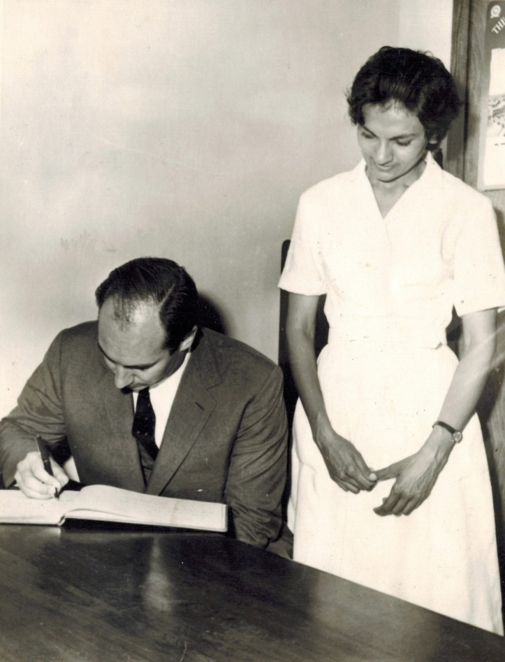 Aga Khan signs guest book at Girls Hostel in Dar es Salaam 1966 visit Barakah and Simerg