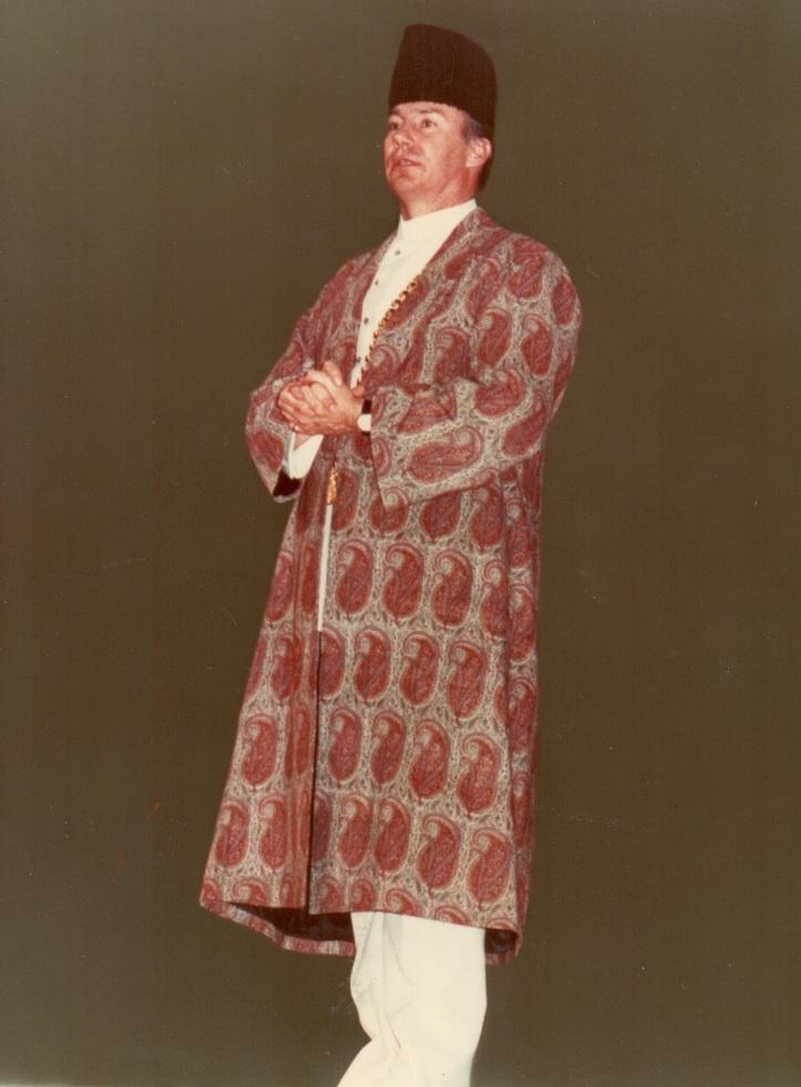 Aga Khan Mawlana Hazar Imam in a darbar robe at a mulaqat, Barakah