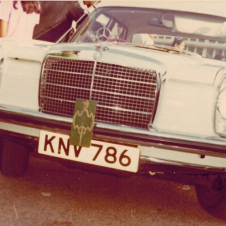 Aga Khan's Mercedes Benz bearing the number plate 786 with his crest and flag, Uganda 1972
