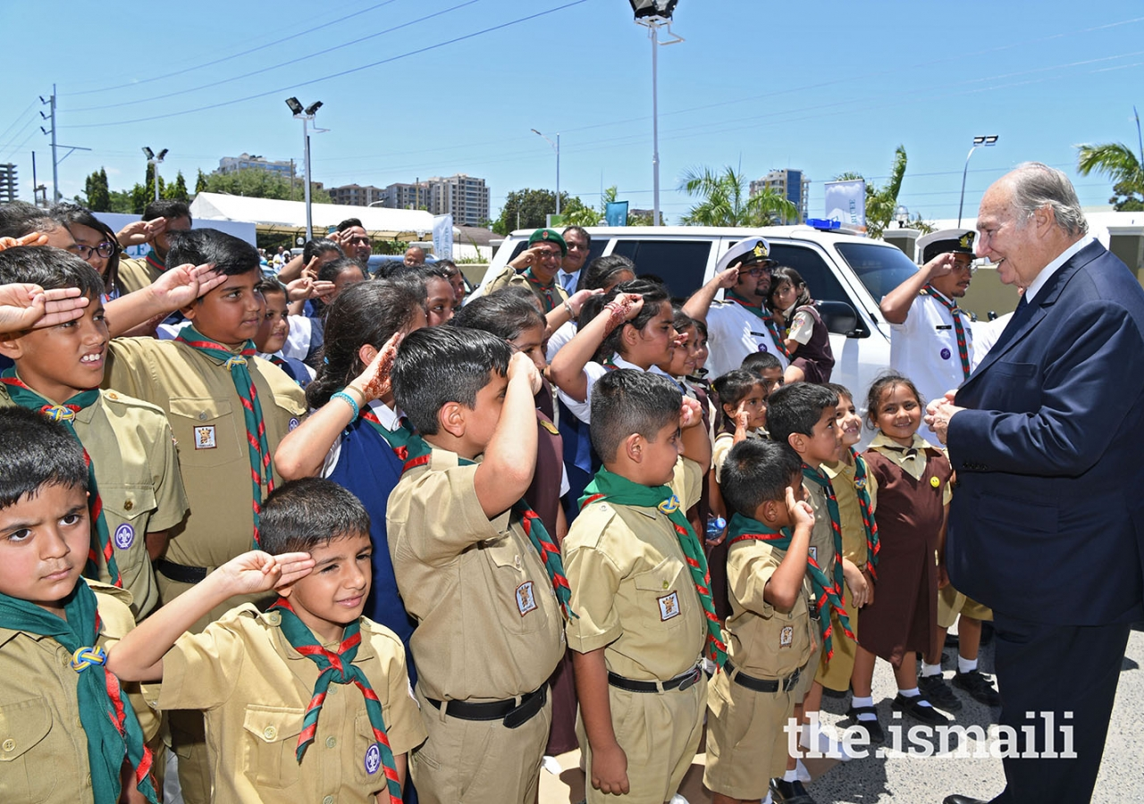 Mawlana Hazar Imam is greeted by Aga Khan Scouts and Guides, as he leaves Diamond Jubilee Hall after the Darbar. Photo: The Ismaili/Zahur Ramji.