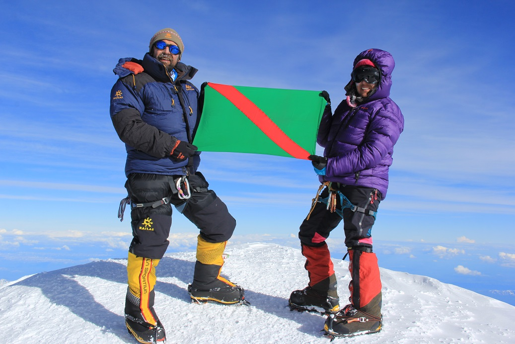 Ismaili mountaineers Samina Baig and her brother Mirza Ali hoist the Ismaili Flag after reaching the summit of North America's highest mountain, Mt. McKinley, in Alaska,