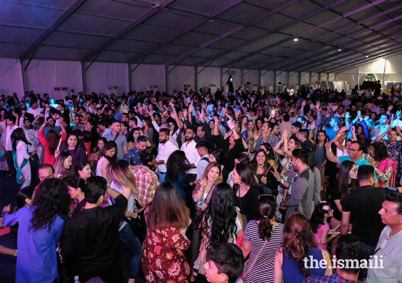 Ismailis enjoy the stick dance and raas at Aga Khan Diamond Jubilee in Portugal